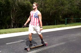 Trey Camp rides his electric longboard.
