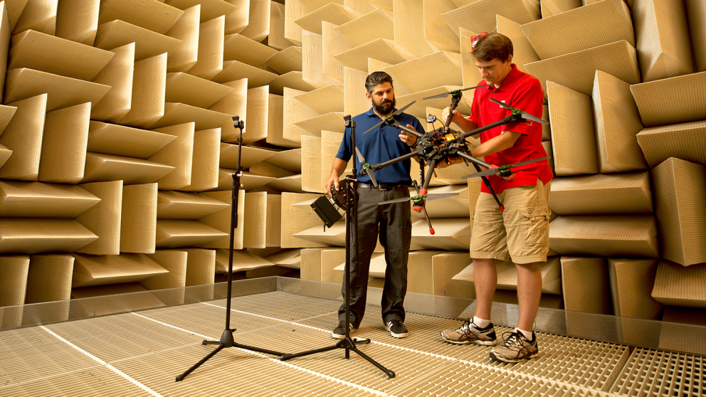 MAE graduate student Thomas Powers, right, works with Woodus (Rocky) Mintz in the anechoic chamber on a multirotor hexacopter that Mintz built. Mintz is the owner of Sandhills Robotics in Fayetteville, NC. In partnership with TFM & Associates, Inc. Sandhills Robotics works with the MAE department on drone research.