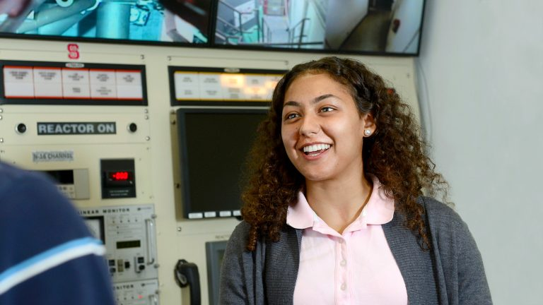 Jasmin Alsaied, a sophomore nuclear engineering student, works in nuclear reactor at Burlington Labs.