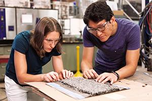 Researchers work in asphalt lab.