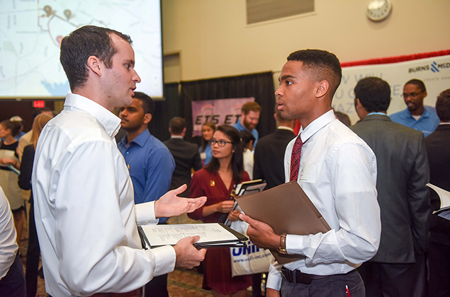Student talks to potential employer at Fall 2016 Engineering Career Fair.