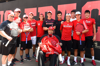 Irwin Holmes poses with the men's team.