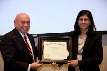 Dr. Louis Martin-Vega, dean of the College of Engineering, presents the 2016 RJ Reynolds Tobacco Company Award for Excellence in Teaching, Research and Extension to Dr. Veena Misra.