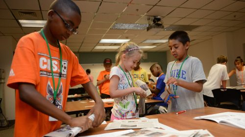 Elementary school campers make furniture from newspapers.
