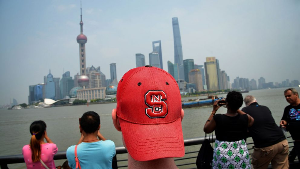 NC State student sports his Wolfpack pride on his head while touring The Bund in Shanghai.
