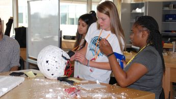 Students participate in summer camp activity.