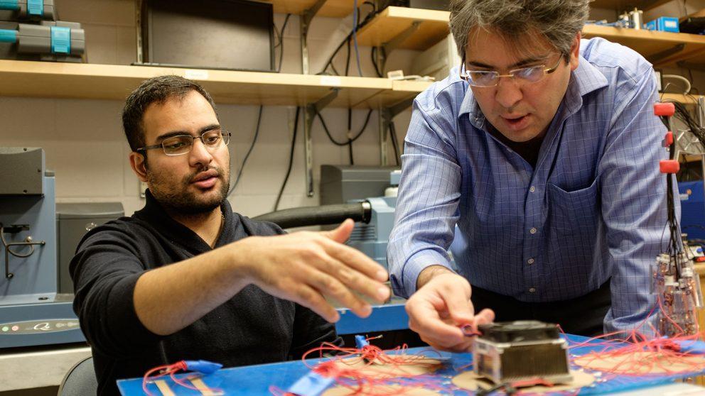 Mohammad Pour-Ghaz with Reza Rathetnia in lab