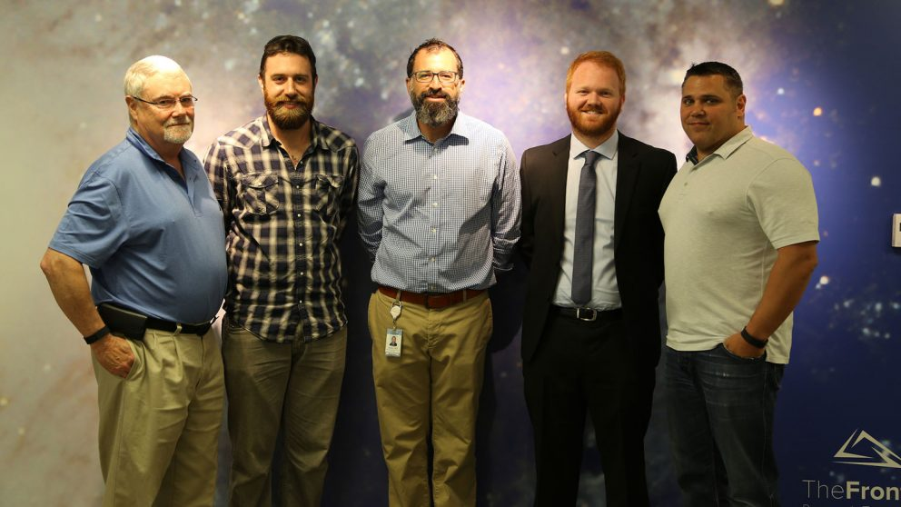 Dr. Andrew DiMeo, third from left, and Andy Taylor, fourth from left, during a Catalysts for Innovation grant announcement.