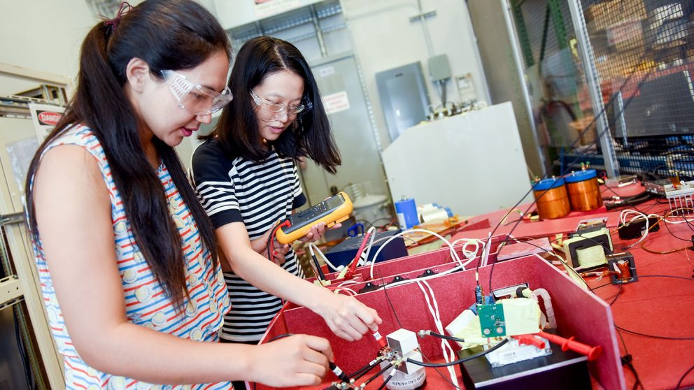 Researchers work in FREEDM lab