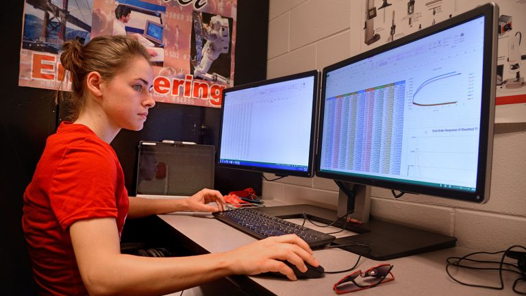 CCC student at computer.
