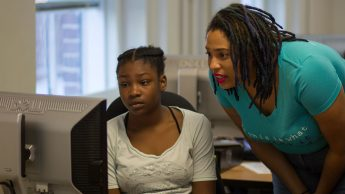 Dr. Brittany Johnson works with a student during the camp.