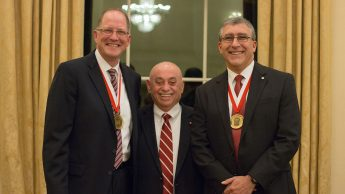 Dr. Louis A. Martin-Vega, dean of the College, recognized 2017 Distinguished Engineering Alumni Hassan and Icenhour at a banquet on Nov. 1.