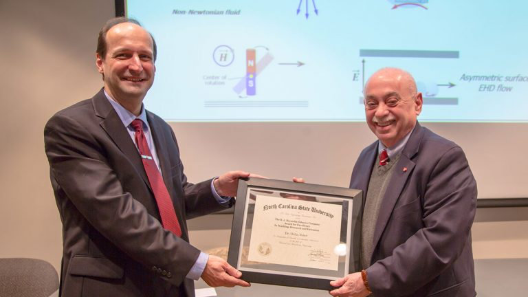 Dr. Louis Martin Vega (r), dean of the College of Engineering, presents the 2017 RJR Award to Dr. Orlin Velev, INVISTA Professor in the Department of Chemical and Biomolecular Engineering at NC State.