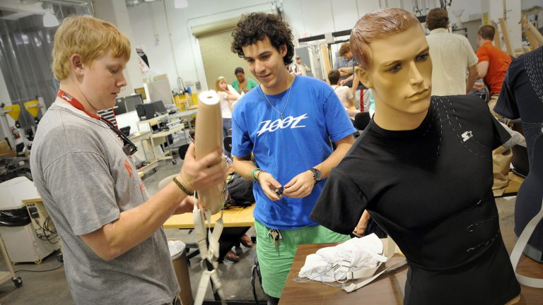 College of Textiles students work on a project in the textile engineering lab.