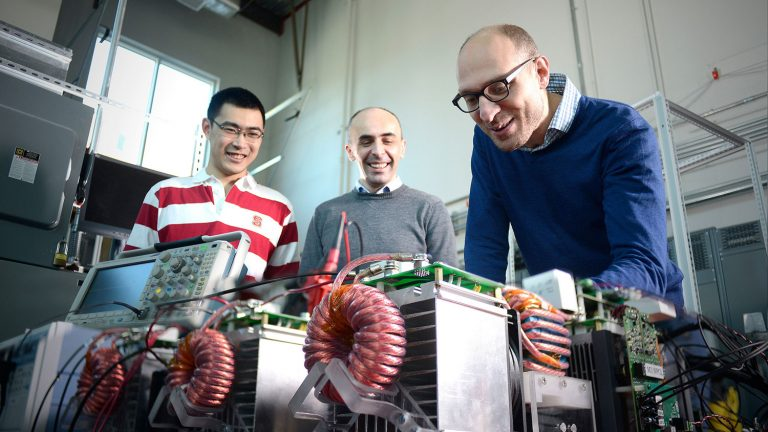 Electrical engineering researchers working in FREEDM lab