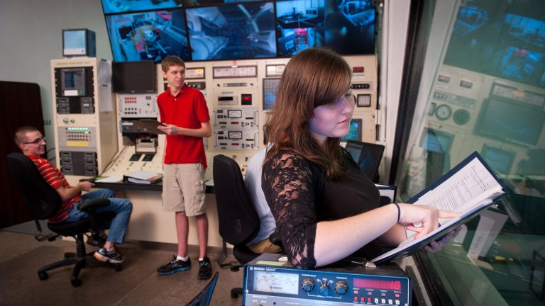 Nuclear engineering students work in the Nuclear reactor control room in Burlington Labs.
