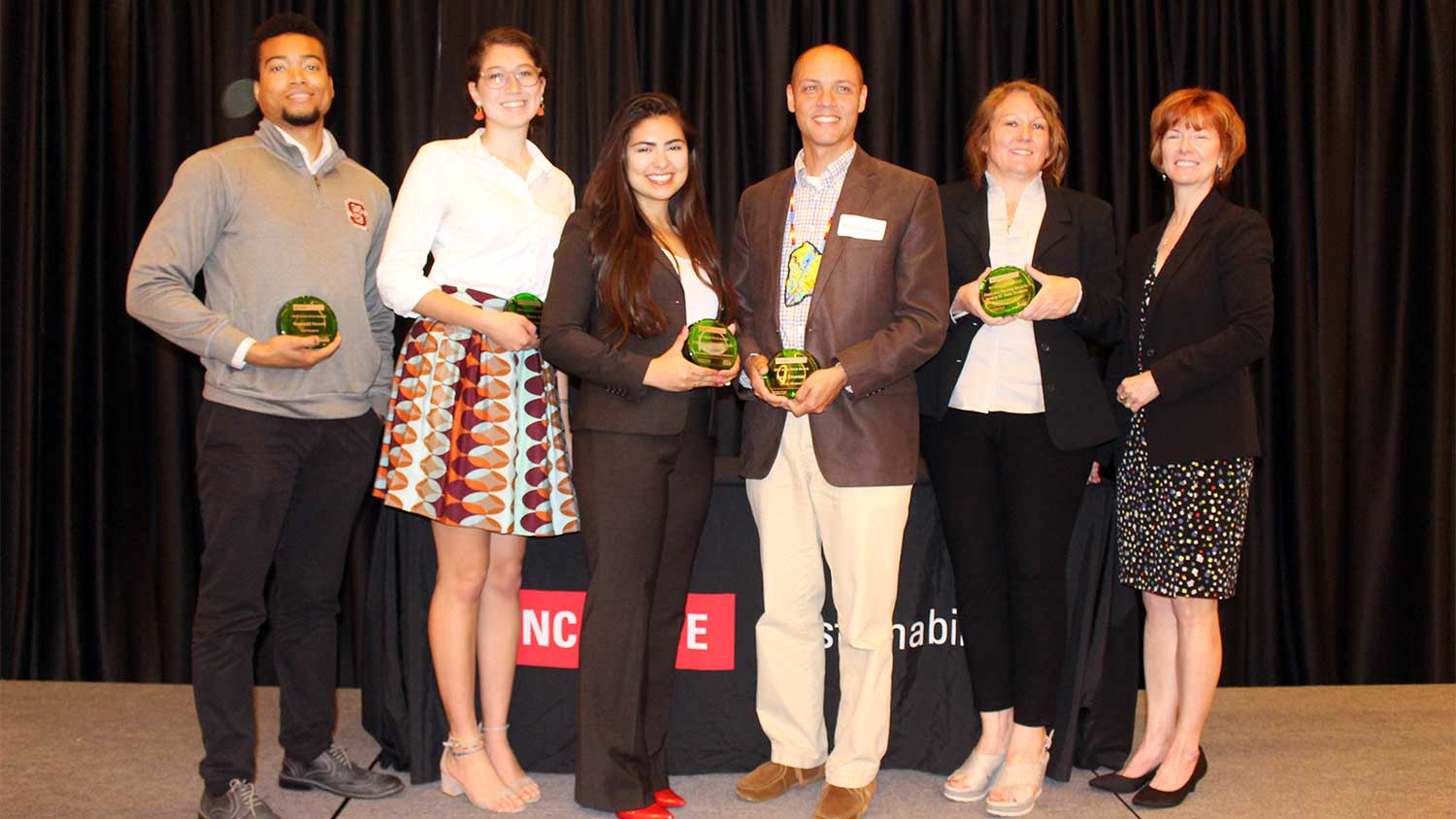 Green Brick Award winners (left to right) Reggie Howell, Mary Paz Alvarez Valverde, Engineers Without Borders president Michelle Lishner, Dr. Ryan Emanuel, and Food and Housing Security initiative representatives Sarah Wright and Dr. Mary Haskett.