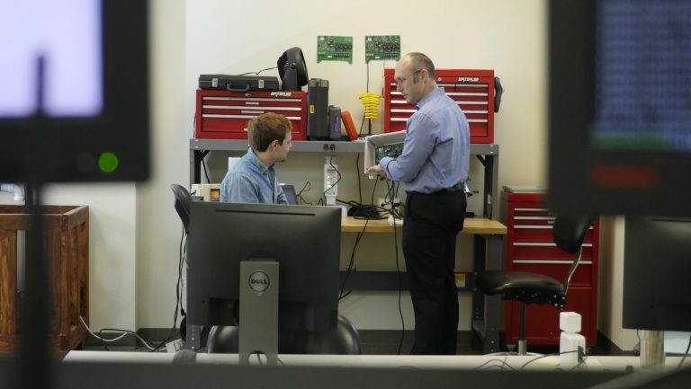 Pentair Engineering Manager Brian Boothe collaborates with a student intern in the company's innovation center on Centennial Campus.