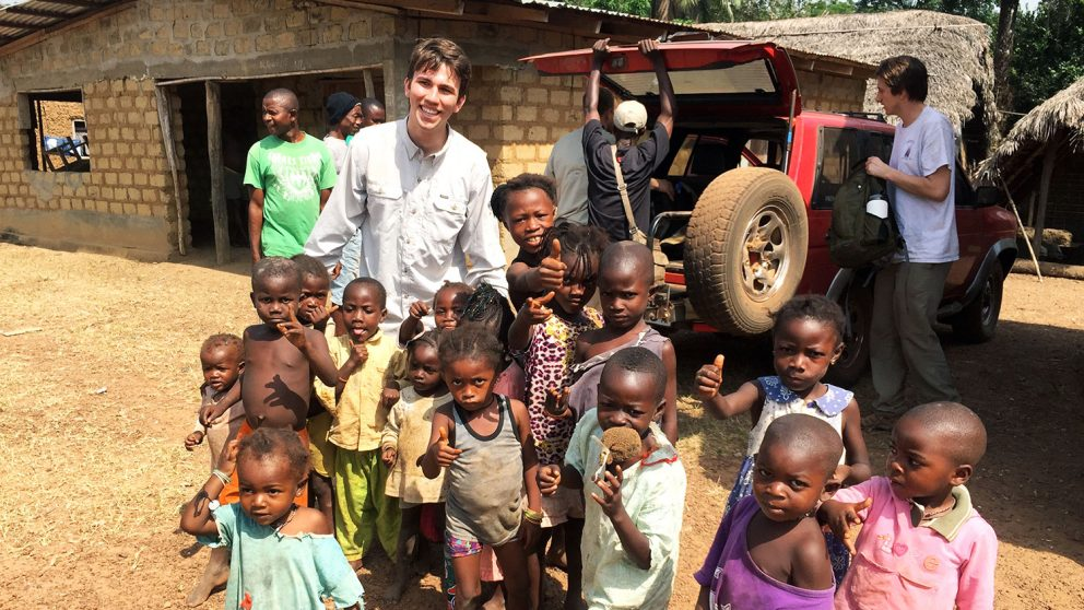 Member of NC State chapter of Engineers Without Border with children in Sierra Leone