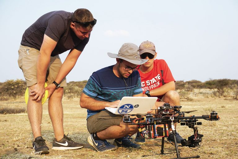 Three undergraduate students study the reactions of animal wildlife to UAVs.