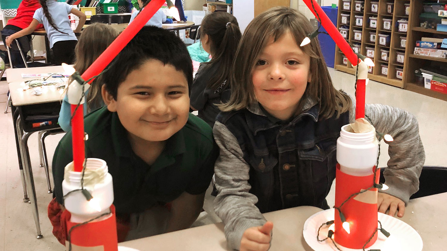 Two elementary school students working on a STEM project