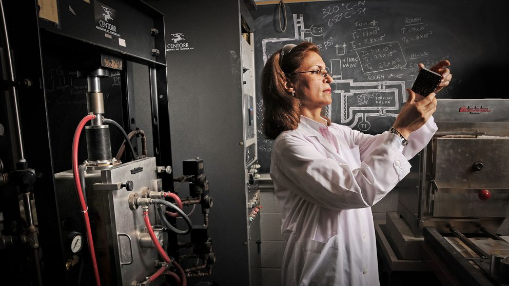 Dr. Afsaneh Rabiei examines composite metal foam in her lab.