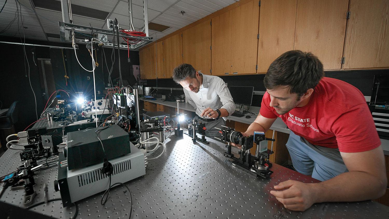 Dr. Michael Kudenov and graduate student work in Optical Sensing Lab.