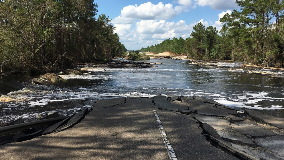 A cracked highway disappears into flood waters. (Photo: Brina Montoya)