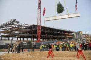 The College of Engineering celebrated progress on the new Fitts-Woolard Hall on Dec. 12 with a Topping Off Celebration and lunch. The event marked the placing of the highest, but not last, steel beam in a new building's frame.