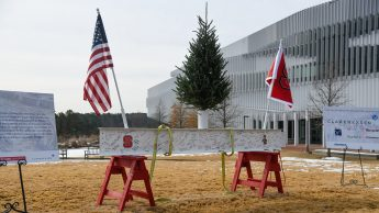 The high beam, which sits at the top of an elevator shaft in the building, was painted white. It was placed on two NC State red saddle horses on the morning of the 12th, and workers and NC State students, faculty and administrators were invited to sign it.