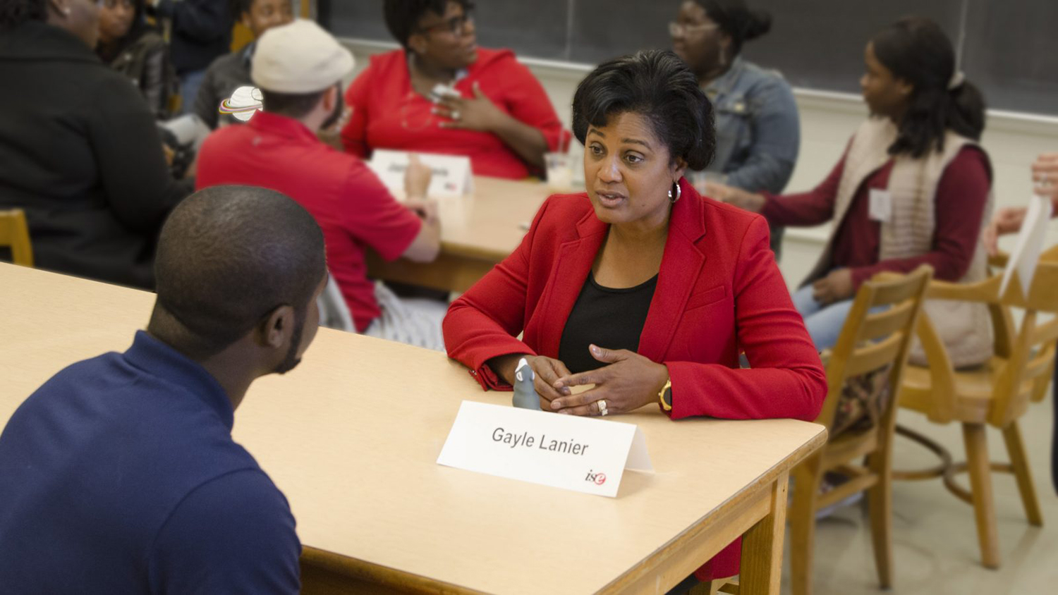 ISE alumna Gayle Lanier interacts with student at minority recruitment event.