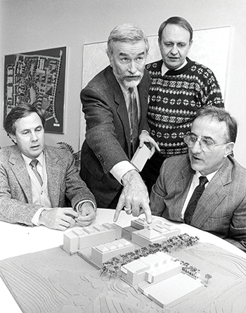 In this photo taken that year, from left, Dr. Jerry L. Whitten, Claude E. McKinney, Dr. Ralph K. Cavin III and Chancellor Dr. Larry K. Monteith look over a model of early buildings on the campus.