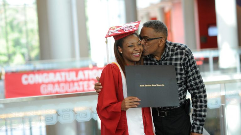 Departmental graduation ceremonies at Talley, 2016. Criminology grad Tatiana DeBerry is congratulated by family. Photo by Marc Hall