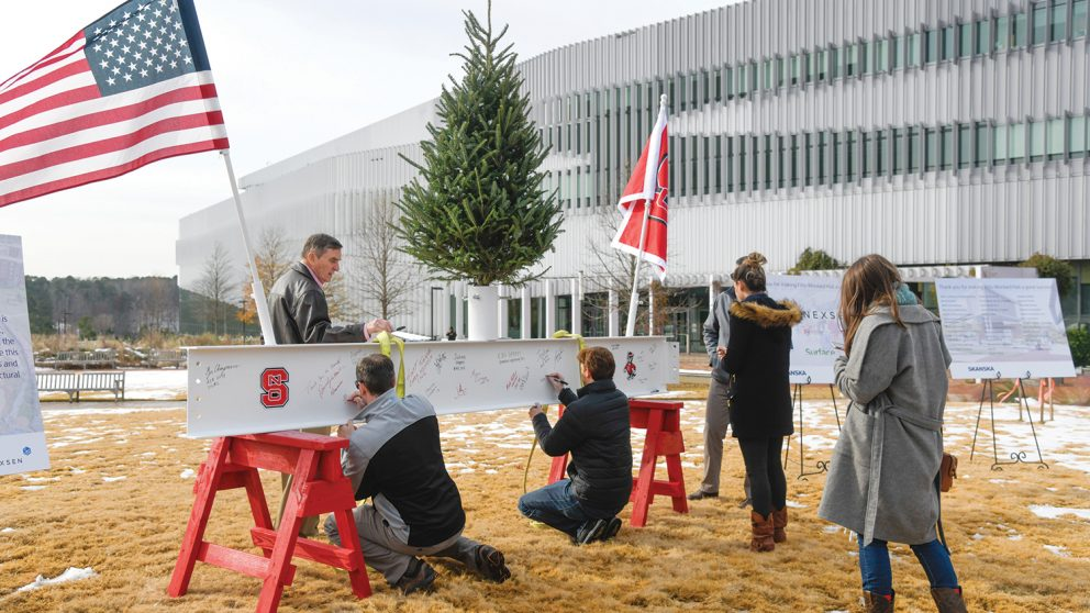 At the Topping Off Celebration, the high beam, which sits at the top of an elevator shaft in the building, was painted white. It was placed on two NC State red saddle horses on the morning of the 12th, and workers and NC State students, faculty and administrators were invited to sign it.