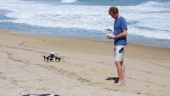 Member of the research team operates drone to evaluate the topographic surface and conduct geospatial analysis.