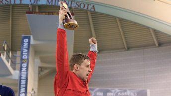 Ipsen holds trophy over his head.