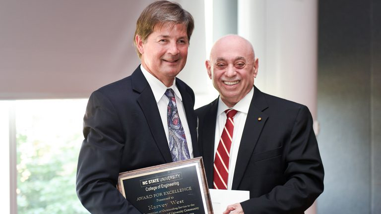 Dean Louis Martin-Vega presents Award for Excellence to Harvey West.