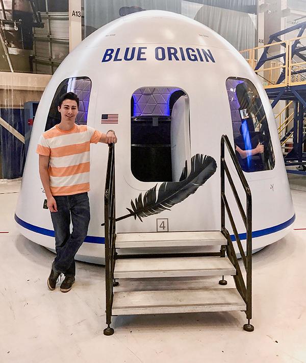 AJ Rackl poses with Blue Origin craft