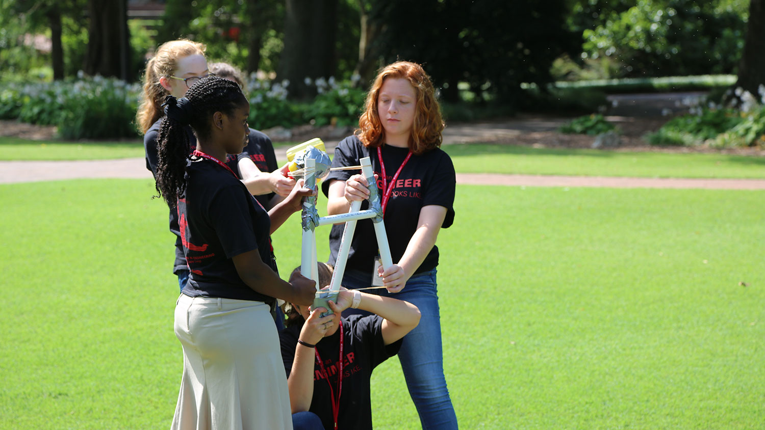 """Incoming female first-year engineers get ready to launch their """"astronaut"""" on the Court of Carolina."""