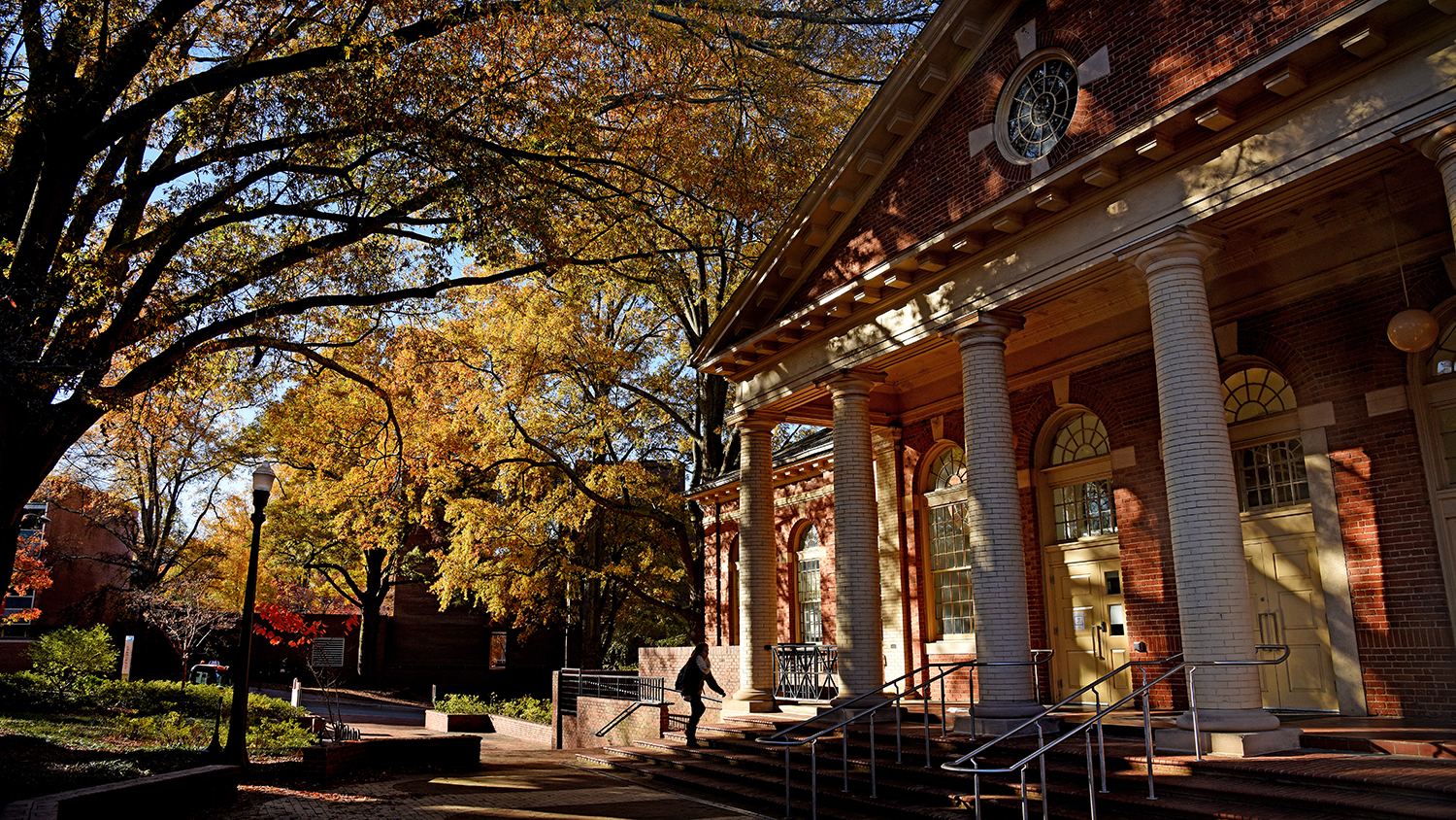 Morning fall sun casts a glow on the College of Design's Leazer Hall.