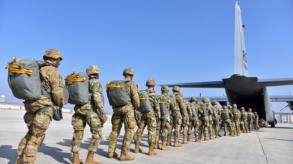 soldiers entering a transport plane