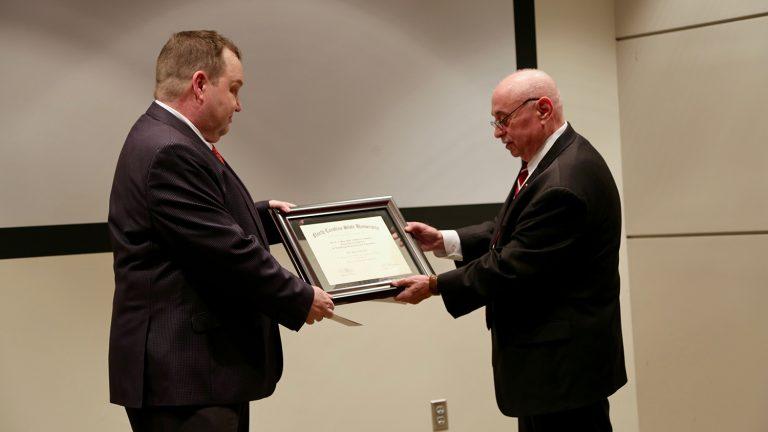 Dean Martin-Vega presents award to Dr. Genzer.