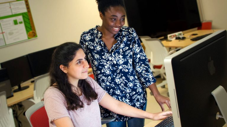 Industrial and systems engineering graduate students Kimia Vahdat, left, and Priscille Koutouan are part of an effort to attract more women students to the department.