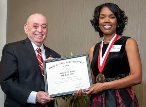 Steffanie B. Easter receives DEA award from Dean Louis Martin-Vega