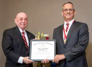 "Jacob T. ""Jake"" Hooks receives DEA award from Dean Louis Martin-Vega"