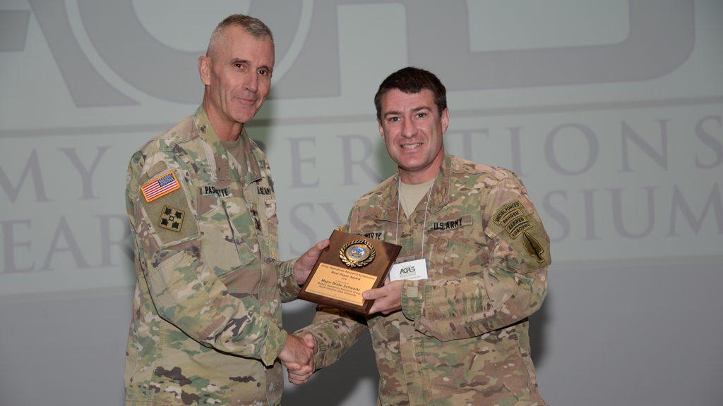 Major Blake Schwartz accepts award.