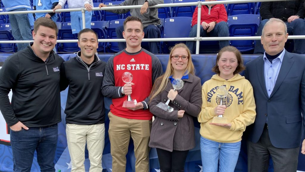 From left to right: Nick Carey, Account Coordinator, Bespoke Sports & Entertainment; Ryan Milroy, Bespoke Sports & Entertainment; Cadet Charles Blum, NC State Air Force ROTC; MIDN Jennifer Fillebrown, Florida, Navy ROTC; Cadet Nicole Butler, Notre Dame, Army ROTC; and Dietrich Kuhlmann, Senior Vice President of Branch Operations, Navy Federal Credit Union. (Photo: courtesy of Navy Federal Credit Union)