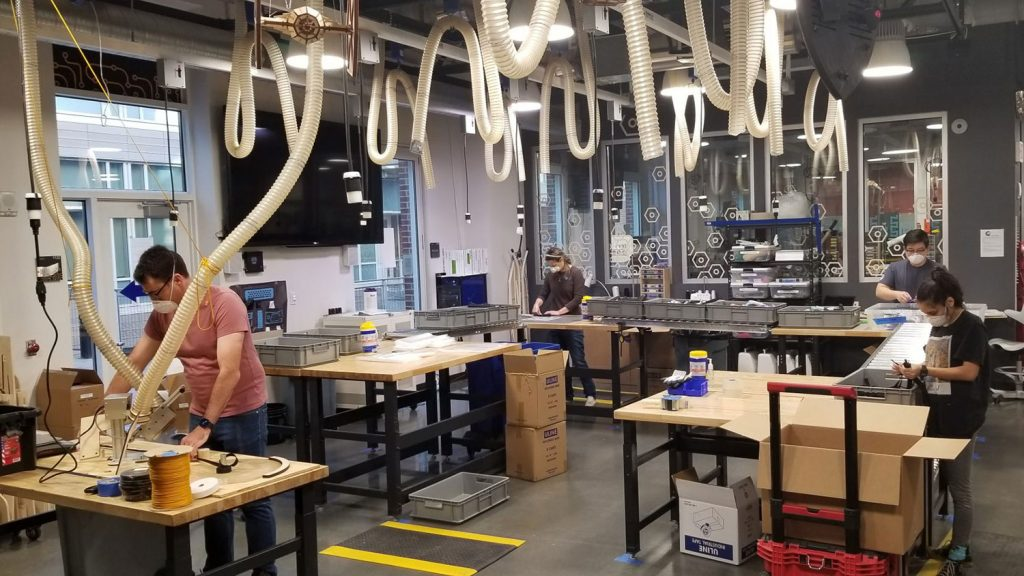 UNC students and makerspace staff volunteers process the materials used to make face shields