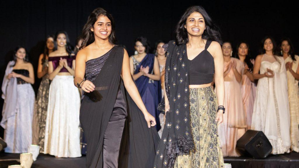 Ritika Shamdasani and her sister Niki, walk on a runway at a Sani fashion show.