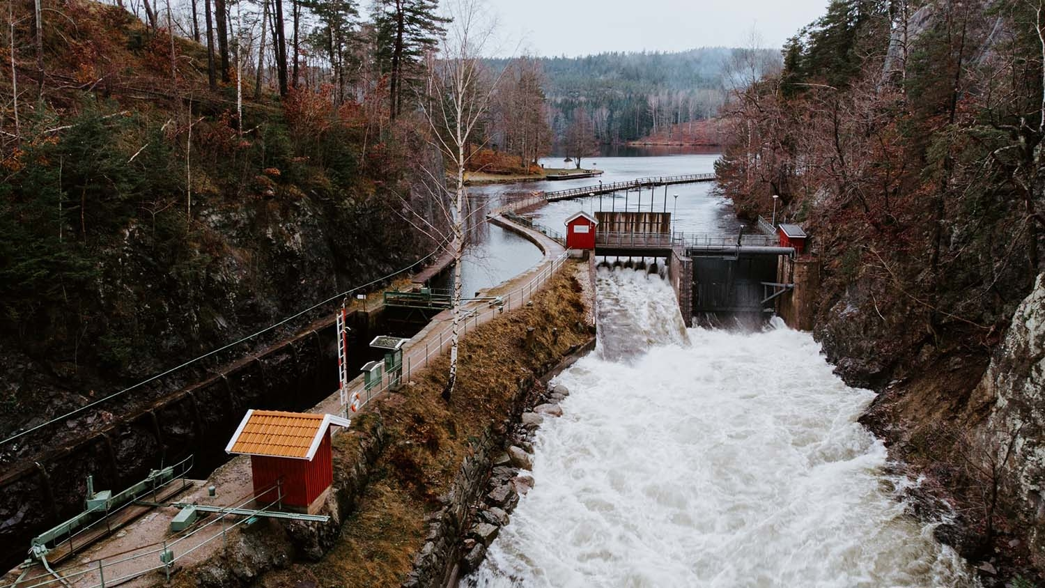 dam draws water from a river to supply a power plant
